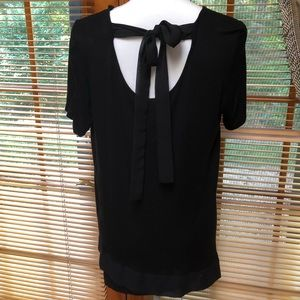 Black top with tie back and sheer bottom